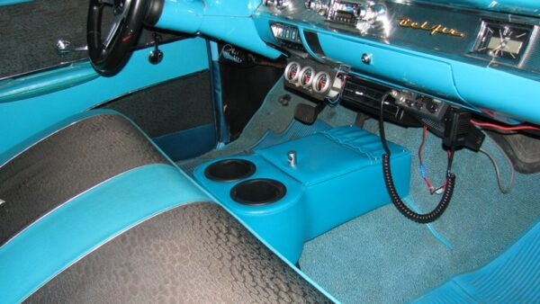 A Low Rider Floor Cup Holder in a 1957 Chevy