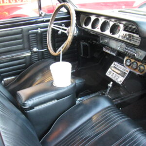 A Pontiac Lemans/GTO Armrest and Drink Holder in Car Side View