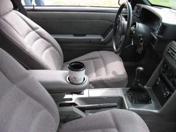 A 1987-1993 Ford Mustang Armrest Cup Holder