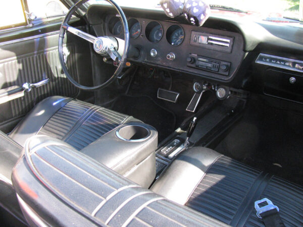 A Pontiac Lemans/GTO Armrest and Drinkholder in Car